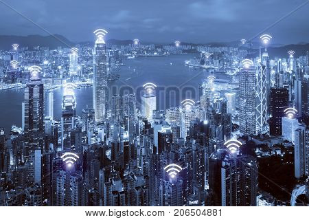 Wifi icon and Hong Kong city with wireless network connection. Hong Kong smart city and wireless communication network abstract image visual internet of things.