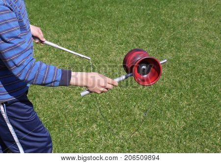 Boy hands playing diabolo, plenty of copy space on the right