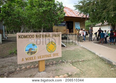 Rinca Island Indonesia - July 25 2017: Guide talking to tourists at the visitor center on Rinca island Komodo National Park Indonesia.