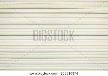 The texture of corrugated metal sheet white or gray galvanizes steel rolling shutter.