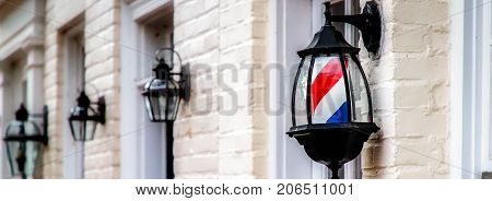 An unusual barber pole on a historic building in northern Virginia.
