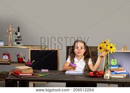 Kid And School Supplies On Grey Wall Background