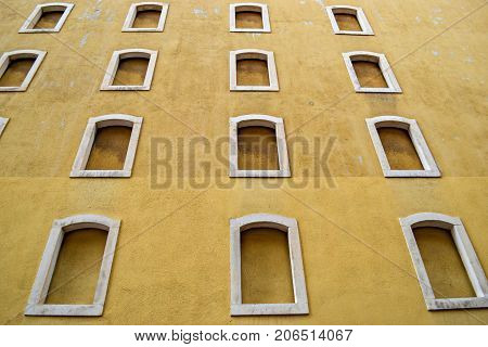 Old yellow building whit windows, street photography