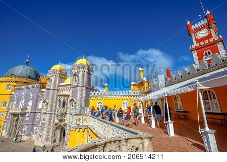 Sintra, Portugal - August 8, 2017: people visits Pena National Palace, in Portuguese Palacio da Pena. Pena Castle is Unesco Heritage and one of Seven Wonders of Portugal and Sintra landmark.