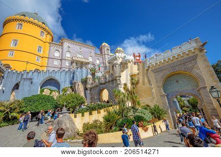 Sintra, Portugal - August 8, 2017: crowd of people at gate of Pena National Palace or Palacio da Pena. Pena Castle is Unesco Heritage and one of Seven Wonders of Portugal and Sintra landmark.