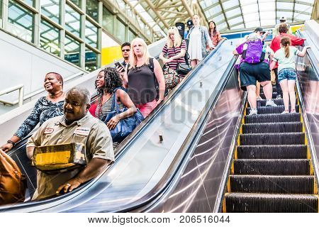 Washington Dc, Usa - July 1, 2017: Inside Union Station In Capital City With People Riding Down Esca