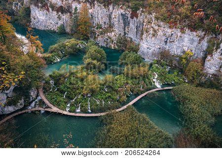 Waterfalls and path in the autumn forest at Plitvicka Jezera - Plitvice