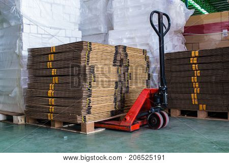 pallet truck with carton boxes, pallet, truck