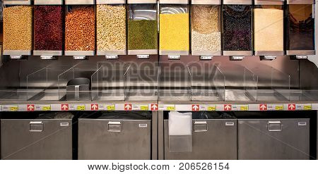 BANGKOK THAILAND - AUGUST 10: Macro Wholesale Market distributes various nuts and beans with mechanical dispensers on August 10 2017 in Bangkok.
