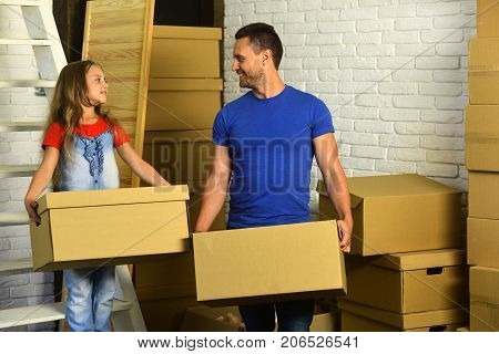 Packing And Family Concept. Kid And Guy Move Into House