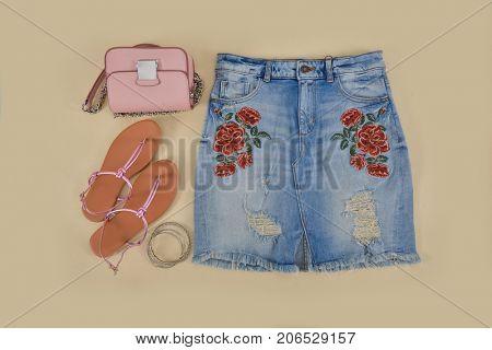 Embroidered flowers skirt jeans, shoes, handbag bracelet,- beige background