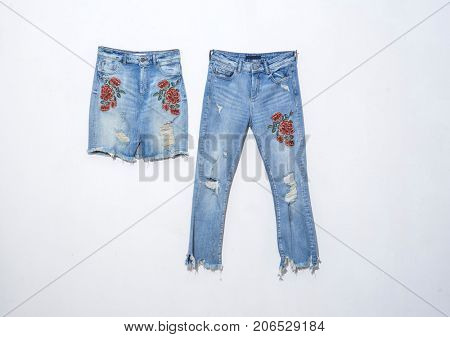 Embroidered flowers jeans with skirt isolated