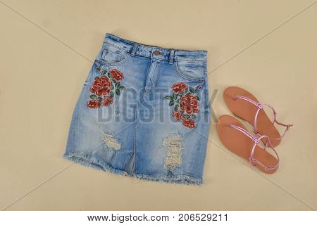 Embroidered flowers skirt jeans, shoes- beige background