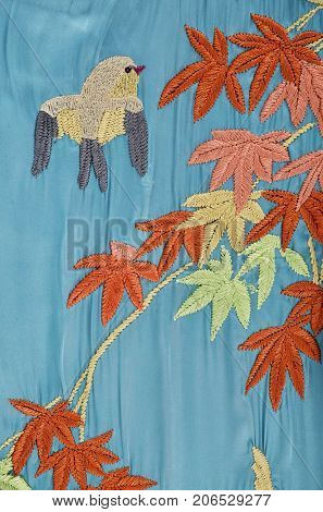 Embroidered bird flowers , jeans texture