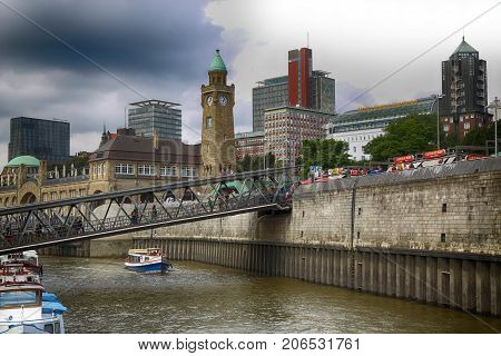 HAMBURG GERMANY - AUGUST 22 2016: Boats and people at the port of Hafencity quarter in Hamburg Germany Hamburg is the second largest city in Hamburg Germany on August 22 2016.