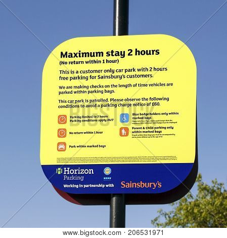Swansea, UK: June 2017: Sainsburys Car Parking Sign stating the terms and conditions of use and how much you'll be fined if over staying the two hour maximun limit. Horizon Parking are able to fine overstayers £60.