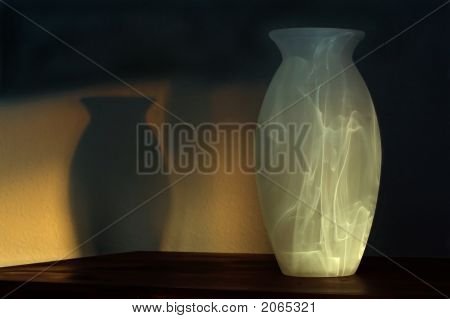 Vase And Shadow At Sunset
