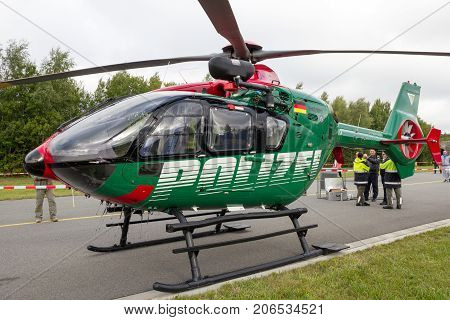 LAAGE GERMANY - AUG 23 2014: Eurocopter EC135 helicopter from the German Police at the Laage airbase open house.