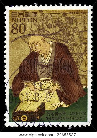 JAPAN - CIRCA 2001: A stamp printed in Japan shows portrait of Takemoto Gidayu, was a joruri narrator from collection of the Osaka City Museum, 350th anniversary of the birth, circa 2001