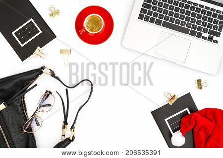 Laptop coffee books christmas decoration on white background. Fashion flat lay for social media