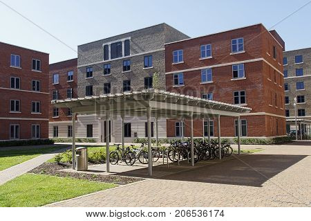 Swansea, UK: June 17, 2017: The Swansea Bay Campus is located right on the beach on the eastern approach to Swansea, and is the home to the College of Engineering. Bicycles stored in a bike rack in the grounds by the student accommodation.