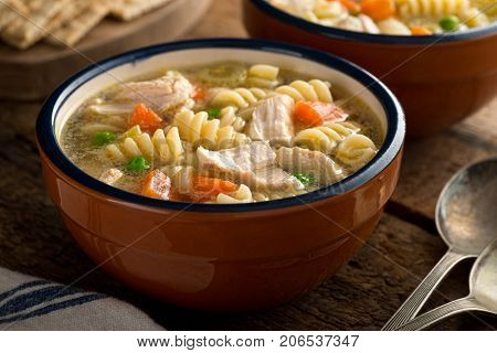 A bowl of delicious homemade chunky chicken noodle soup.
