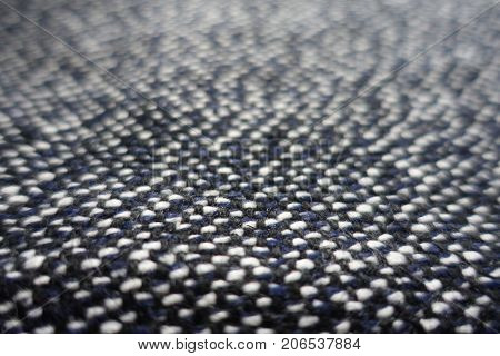 Close View Of Tweed Fabric Woven From Black, White And Blue Threads