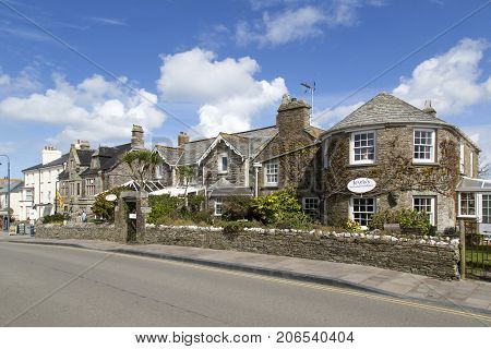 Tintagel, Cornwall, UK: April 14, 2016: The main road through Tintagel with traditional stone built hotels, houses and pubs.