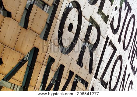 Cardiff, UK: March 2016: Architectural detail of the Millennium Centre in Cardiff which comprises a large theatre and two smaller halls with shops and restaurants. The facade is made of copper oxide.