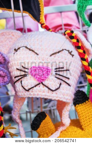 Funny winter knitted hat in the form of a cat, close-up