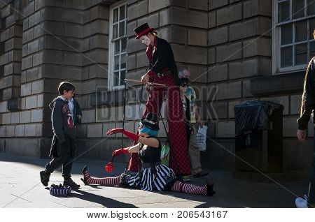 Edinburgh Scotland - August 10 2010: Street artists performing in a street of Edinburgh during the Fringe Festival in Scotland United Kingdom