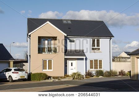 Swansea, UK: March 31, 2016: A large detached family house in an upmarket development with driveway and garage.