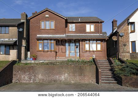 Swansea, UK: March 11, 2016: A large luxury detached house in an upmarket housing estate. Prices of large detached houses in prime locations have escalated enormously in the last decade.