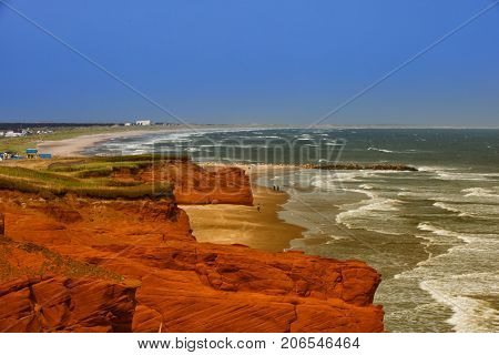 Red cliff in Havre aux maisons in Magdalen island in Canada with the ocean in background