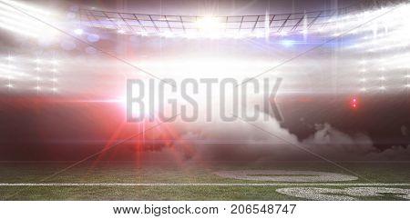 Digitally generated image of illuminated stadium with smoke