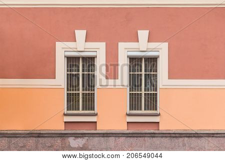 Two windows in a row on facade of urban office building front view St. Petersburg Russia