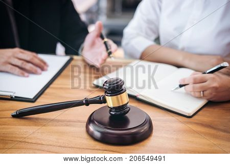 Male lawyer or judge consult having team meeting with client Law and Legal services concept.