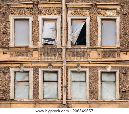 Several windows in a row on facade of abandoned urban building front view St. Petersburg Russia