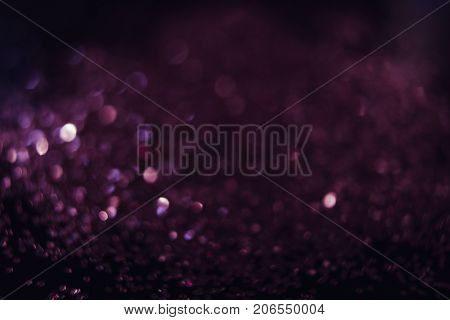 Abstract shining glitters violet background. Blurred multicolored tinsel. Defocused glisten foil backdrop, christmas magic , eyeshadow closeup concept