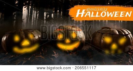 Graphic image of ghoulishly Halloween text against forest full of smoke