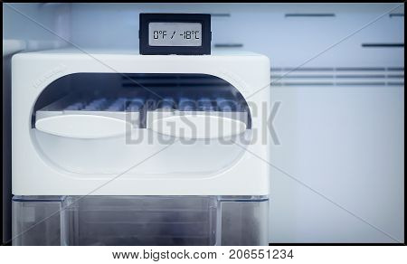 Digital Thermometer shows Ideal Temperature of Freezer at 0° F (-18° C)