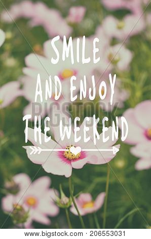 Weekend motivational and inspirational quotes - Smile and enjoy the weekend. Retro styled and blurry background