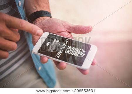Graphic image of mortgage text with icon and chairs against midsection of man using phone