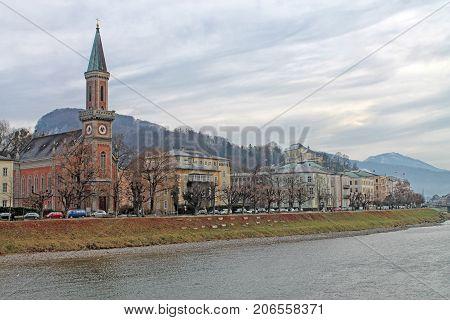 View of Salzburg with Protestant parish Salzburg Christ Church and Salzach river in winter, Salzburg, Salzburger Land, Austria
