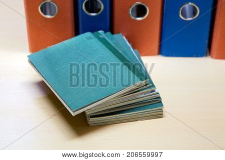 Labor books on the background of business folders. Labor relations with employees