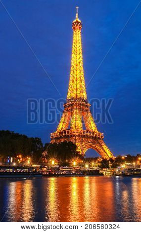 PARIS - 23 SEPTEMBER , 2017: Eiffel Tower in the Dusk on September 23, 2017. The Eiffel tower is the most visited monument of France located oh the bank of Seine river in Paris, France.