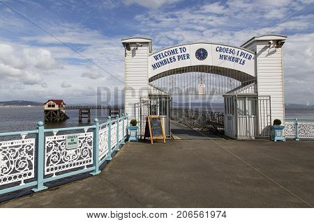 Swansea, UK: September 10, 2016: Main entrance to the Victorian era Mumbles Pier in Swansea with a Welcome in English and Welsh.