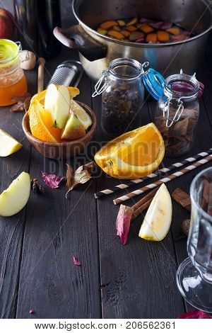 Christmas mulled wine and ingredients. Top view with copyspace , winter warming drink. Bottle of wine, honey, orange, cinnamon sticks, anise, nutmeg, cloves and glass from above.