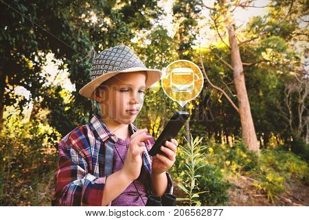 Digital composite image of bus icon on green circle against boy using walkie talkie iat forest