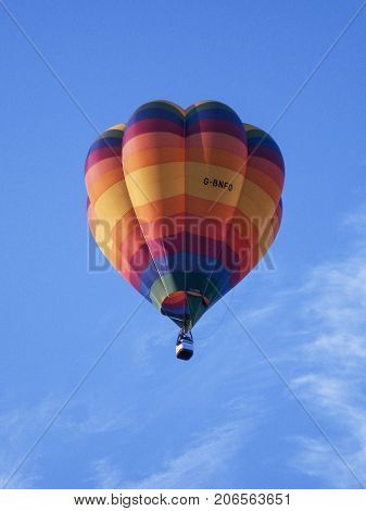 Bristol, UK: August 11, 2011: A multi coloured balloon floats in the air at the International Balloon Fiesta in Bristol. The annual fiesta has become Europe's largest hot air balloon festival.